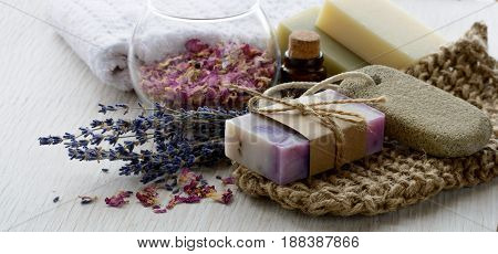 Handmade Lavender Soap with bath and spa accessories. Dried lavender and rose petals with aroma oil for banner or background