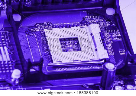 CPU socket on a computer motherboard macro close.