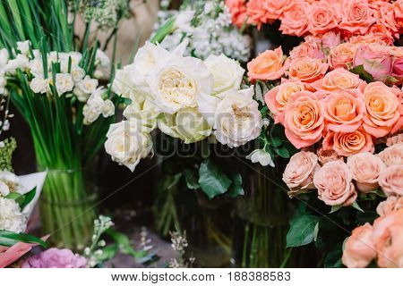 Gorgeous bouquets of pink and white roses and tenderless white peonies