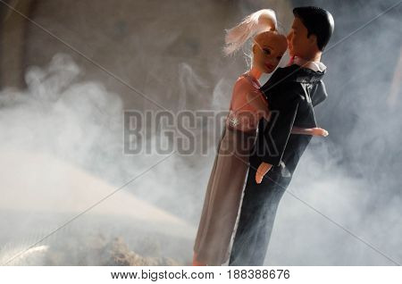 Doll Wedding Couple Indoors Is Hugging Each Other. Beautiful Model Girl In White Dress. Man In Suit.