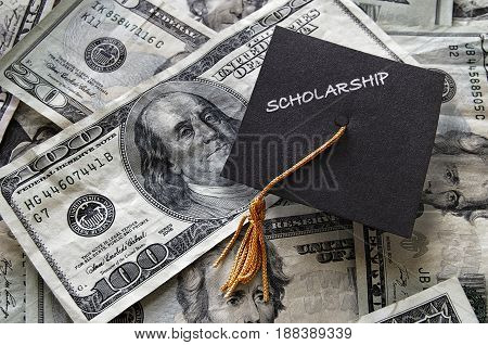 Scholarship mini graduation cap on assorted cash