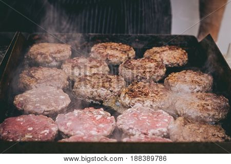 Cooking Delicious Juicy Meat Burgers On The Grill Outdoor