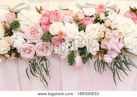 Wedding flower decor of roses, tulips and white peonies, closeup