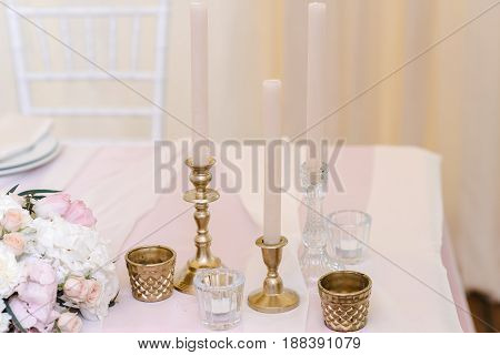 Guest table with with luxury candlesticks and beautiful tableware, closeup