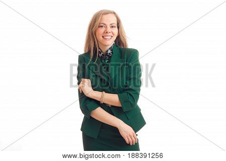 young cheerful blonde in green costume looks ahead and laughs is isolated on a white background