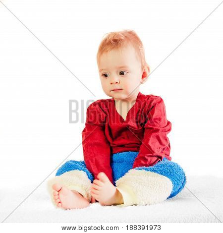 Portrait of a baby boy on a white background .