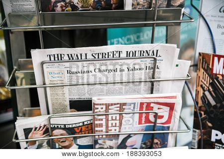 PARIS FRANCE - MAR 23 2017: The Wall Street Journal and other international magazines covers at press kiosk newsstand featuring headlines about the Russians Charged for the Yahoo hack