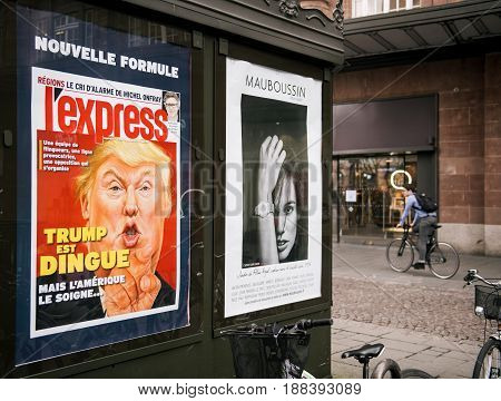 PARIS FRANCE - MAR 23 2017: French l'Express magazines cover wtih Donald Trum is Craxy cover at press kiosk newsstand (Trump est dingue in French)