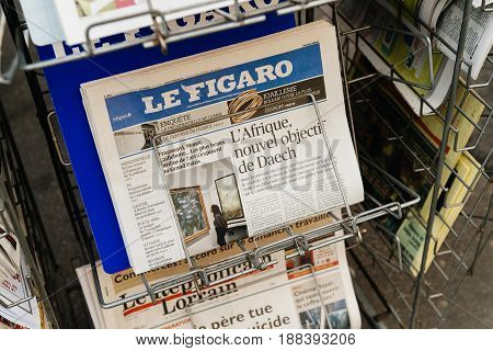 PARIS FRANCE - MAR 23 2017: Africa new targe for Isis main oarticle on the Le Figaro French press at kiosk newsstand featuring headlines