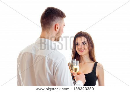 the young man turned to a beautiful girl and drinking wine with her close-up isolated on white background
