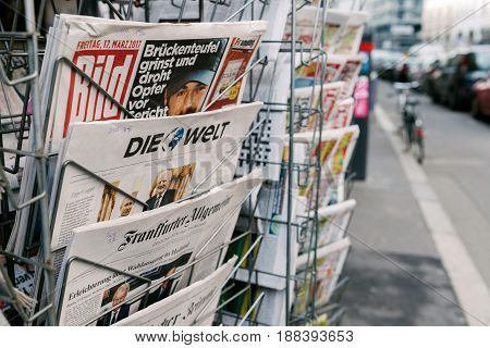 PARIS FRANCE - MAR 23 2017: Die Bild and other German international magazines covers at press kiosk newsstand featuring newsworthy headlines
