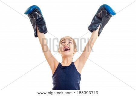little girl boxing winner screaming with hands up in the air isolated on white background