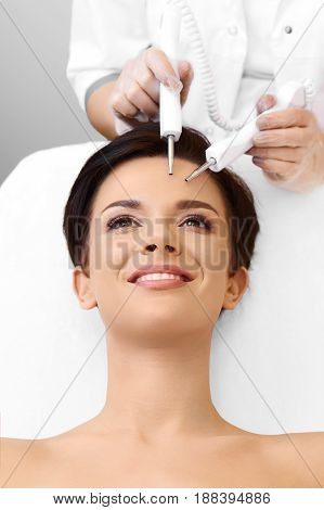 Hardware Cosmetology. Spa Clinic. Beautiful Woman At Facial Treatment Procedure. Microcurrent Therap