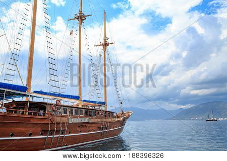 Boat on the marmaris seaport with the mountains background