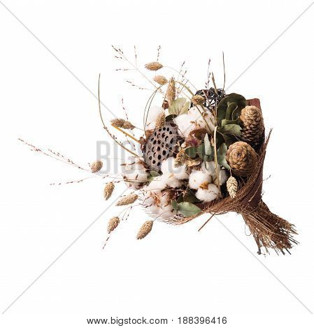 Professionally made bouquet from natural dried lotus seed pod, cotton ball, cones, eucalyptus leaves, ears of rye and floristic ornaments.