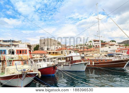 Marmaris castle in marmaris port with boats and sea view