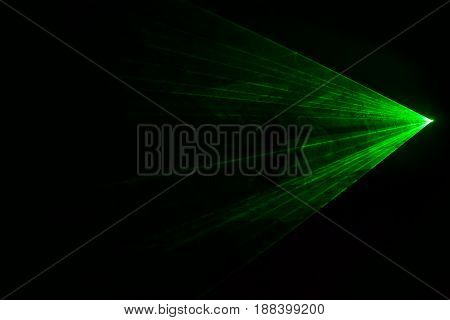 Disco green laser with triangular shape. Seen from the side