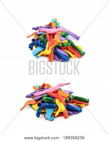 Pile of multiple colorful unblown balloons isolated over the white background, set of two different foreshortenings