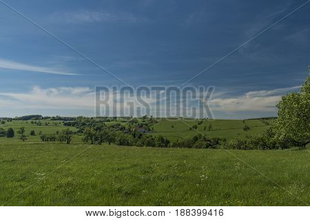 Green blue view in Krusne hory mountains in spring nice sunny day