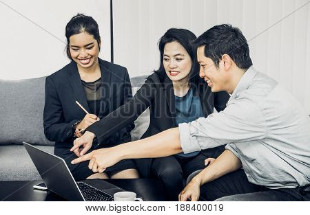 Asian businessman and businesswoman working togerther in officeTeamwork concept.