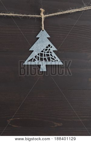 Vertical Metal Pine Tree Ornament hanging on twine