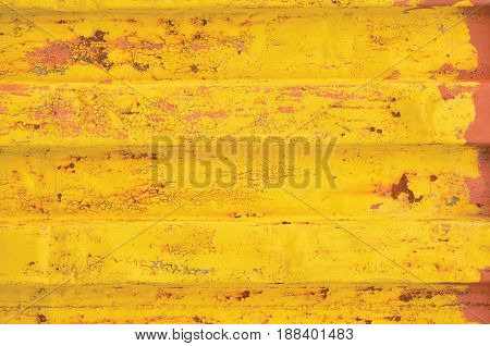 Yellow sea freight container background rusty corrugated pattern red primer coating horizontal rusted detailed steel texture crakcked grungy metal paint detail old aged weathered textured rust metallic grunge copy space closeup