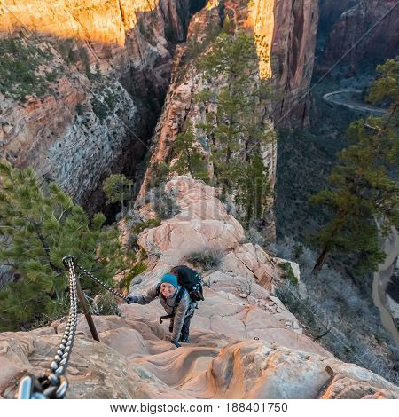 Woman Looks Up as She Hikes The Spine of Angels Landing in Zion