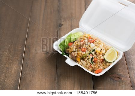 Hot Food In Foam Box On Wood Table