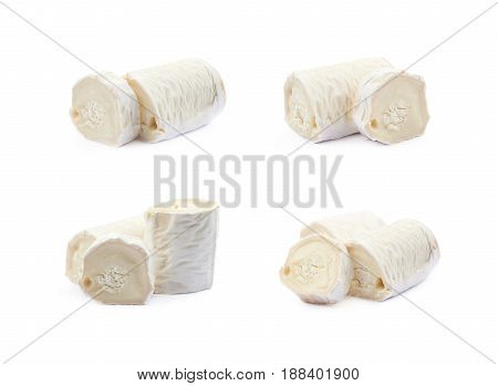 Stick of a goat cheese isolated over the white background, set of four different foreshortenings
