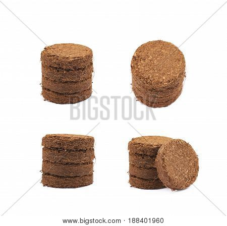 Pile of multiple compressed compost tablets, composition isolated over the white background, set of four different foreshortenings