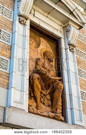 SEATTLE WA - SEPTEMBER 11 2016: Matthew one of the four apostle sculptures installed in 2016 in outdoor window alcoves of the Josephinum (formerly the New Washington Hotel) on Stewart Street.