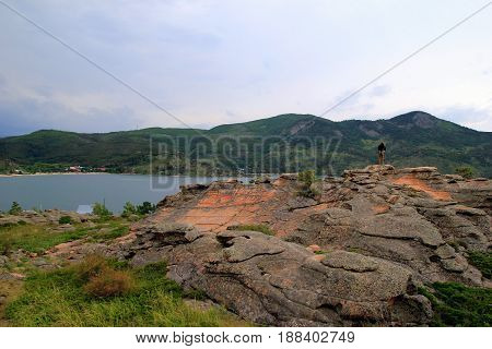 Travel To Kazakhstan, Bayanaul National Park. The Young Man Is Looking On The View With A Lake And M