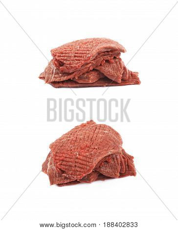 Pile of multiple tenderized slices of raw beef meet isolated over the white background, set of two different foreshortenings