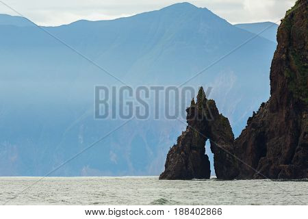 Rocks in Avacha Bay of the Pacific Ocean. The coast of Kamchatka.