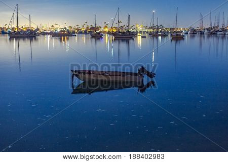 A boat sits in the harbor of point loma