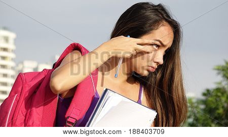 Hispanic Female Student with Backpack and Notebook