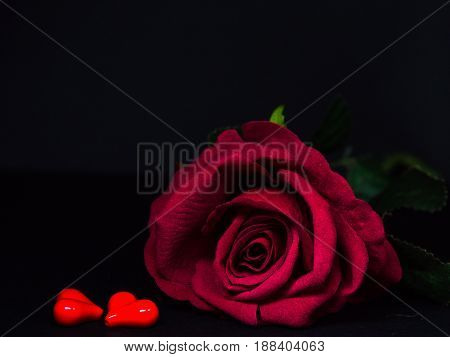 Low key of Valentines Day background-red rose with two red hearts