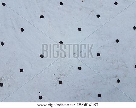 white sheet metal with holes in it