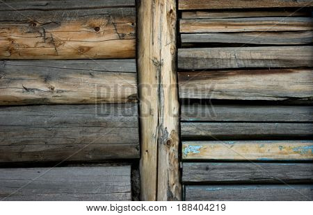 gray brown old log wall, background with wood texture.
