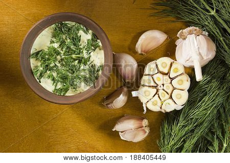 Garlic dip sauce with fresh herbs of dill