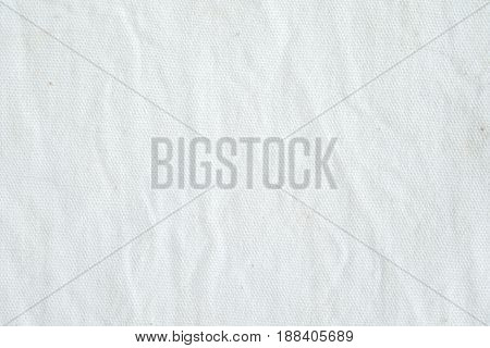 Wrinkled white cotton canvas fabric textured background wallpaper