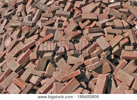 Brown bricks dumped in a huge pile