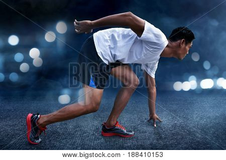 Asian man ready to run with bokeh background
