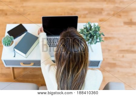 Happy Young Latina Woman Using Her Laptop At Home