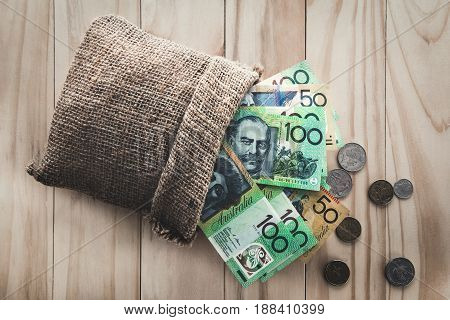 Money Australian dollars (AUD) spilled out from a bag