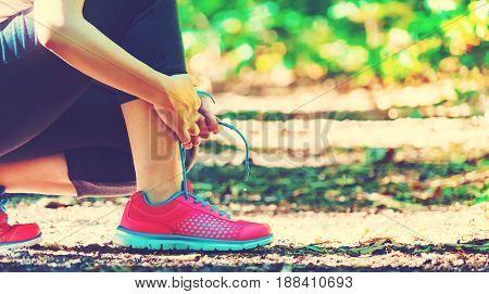 Female Runner Preparing To Jog