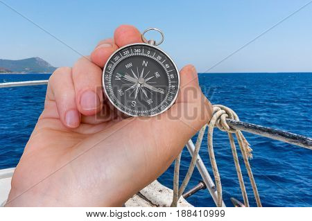 Woman With Compass Is Seeking A Right Way On Sea