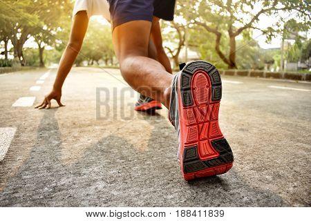 Asian man ready to run in the morning