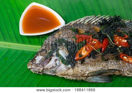 Fried fish (Tilapia) isolate banana leaf,thai food