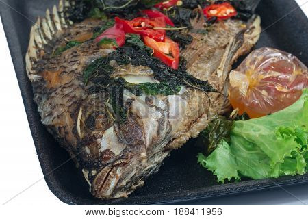 Fried fish (Tilapia) in foam box,thai food